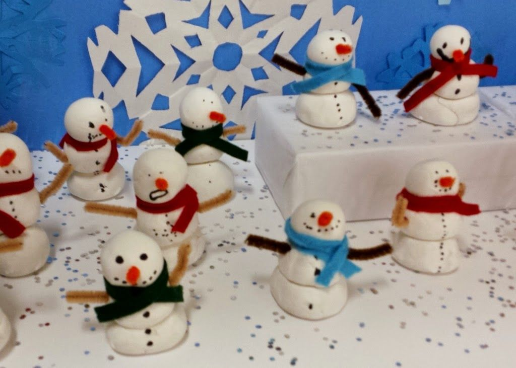 1st graders molded and stacked three spheres to create a snowmen using Crayola Model Magic. Afterwards students drew facial features a...