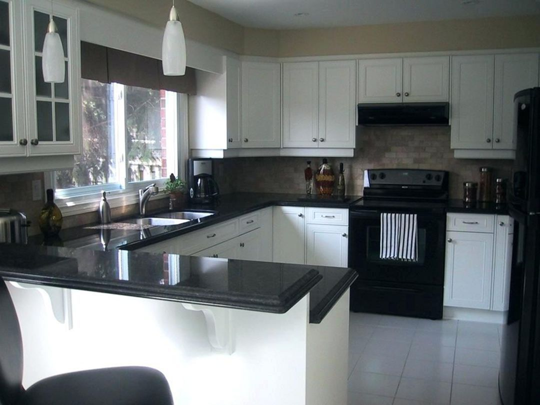 #blackandwhitearmoire | Kitchen cabinets with black ...