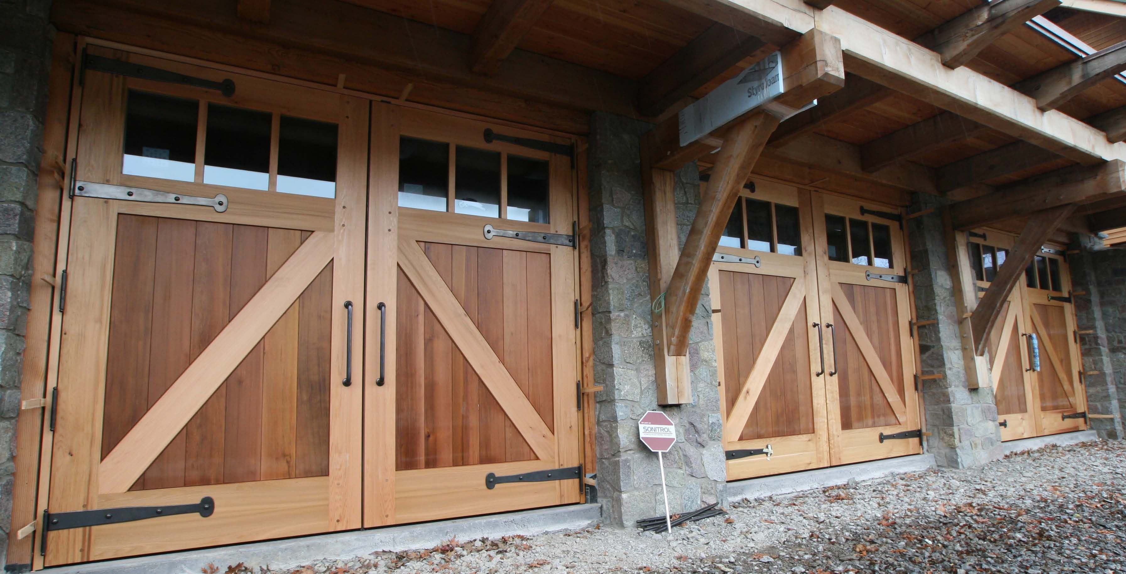 Reclaimed wood railings carriage style doors are custom for Carriage style