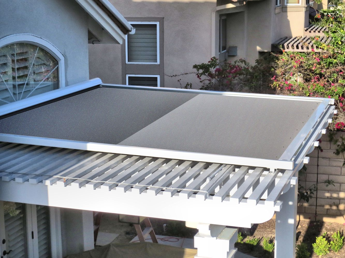 Retractable shade panel on lattice patio cover by superior for Retractable patio awning canopy