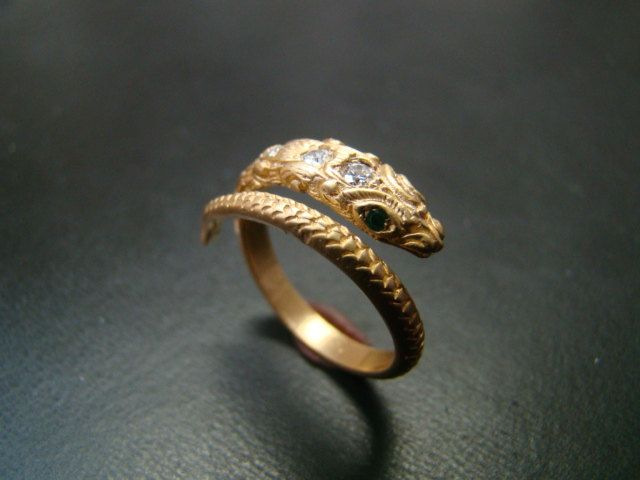 14k Gold amazingly detailed snake ring with diamonds and emerald