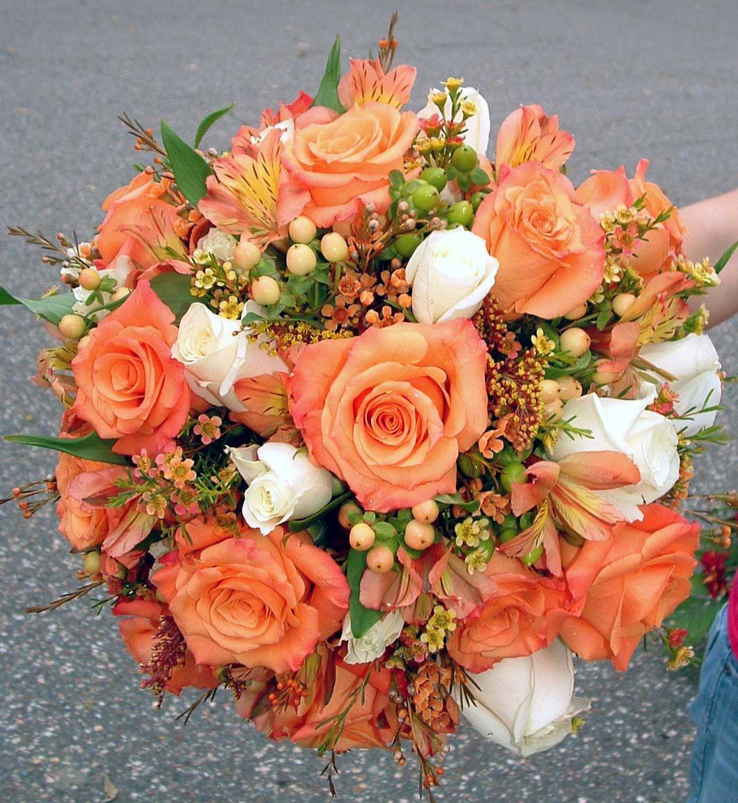 Orange Flower Arrangements For Weddings: Orange And Ivory Rose, Hypericum, And Waxflower Bridal