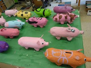 paper mache piggy banks using 2 liter soda bottles, egg cartons and acrylic paint-