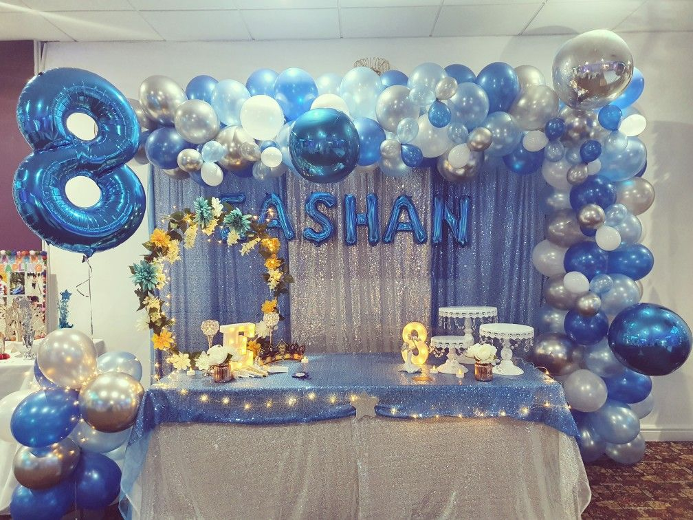 silver and blue birthday backdrop for a birthday boy in