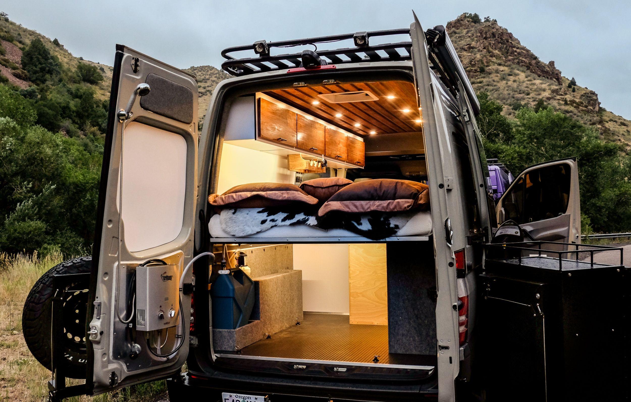A Rear Door Mounted Heated Shower Unit Makes This Space More Than Just Storage Van Life Camper Van Shower Van Conversion Shower