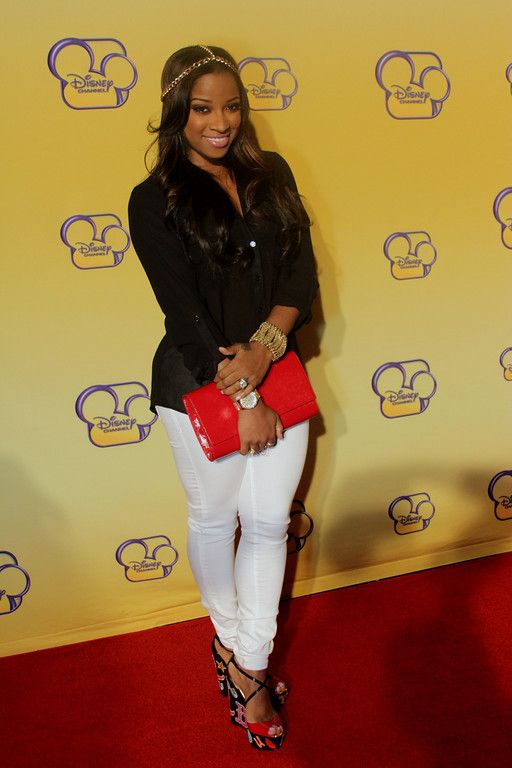 Toya Wright is definitely working these shoes with her Yves Saint Laurent (YSL) clutch.  I love this entire look!