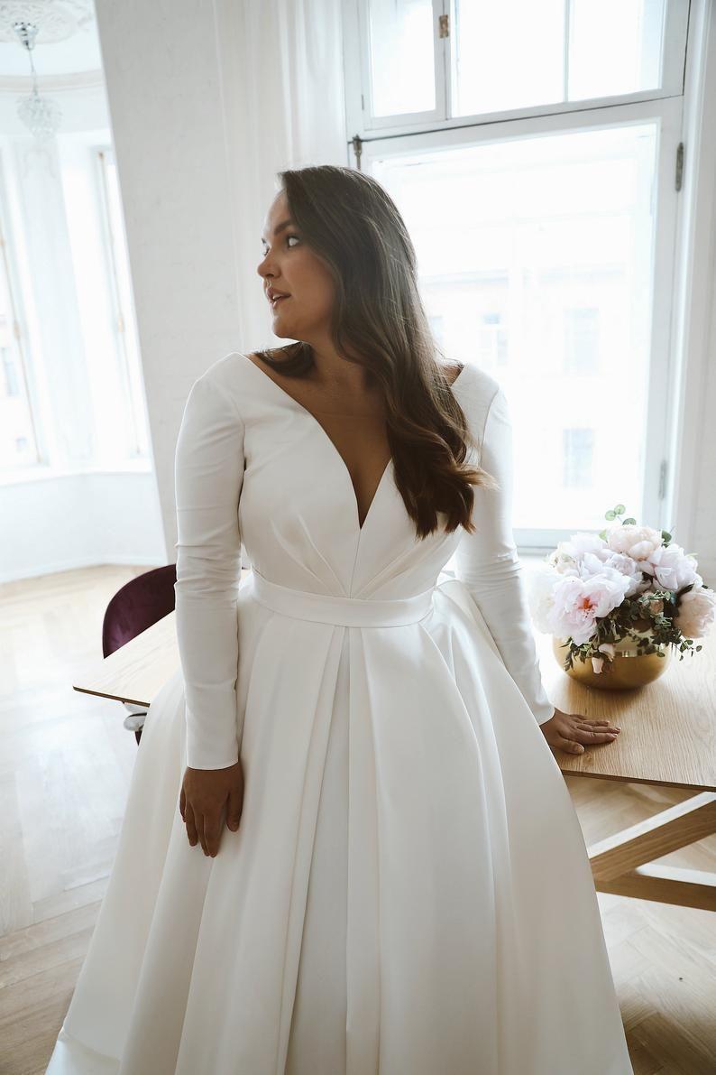 Mikado Wedding Dress Ester By Olivia Bottega Long Sleeve Wedding Dress Pockets On Skirt Deep Neckline Plus Size November Wedding Dresses Wedding Dress Sleeves Plus Wedding Dresses [ 1191 x 794 Pixel ]