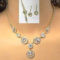 These rhinestone necklace sets present gold plating in a eye catching deign with a circle theme.  Gold is growing in popularity, especially in bridal jewelry.  Follow the link to wholesale rhinestone jewelry to find more options in gold plating that will likely appeal to your customers.   http://www.awnol.com/store/Rhinestone-Jewelry/Rhinestone-Sets