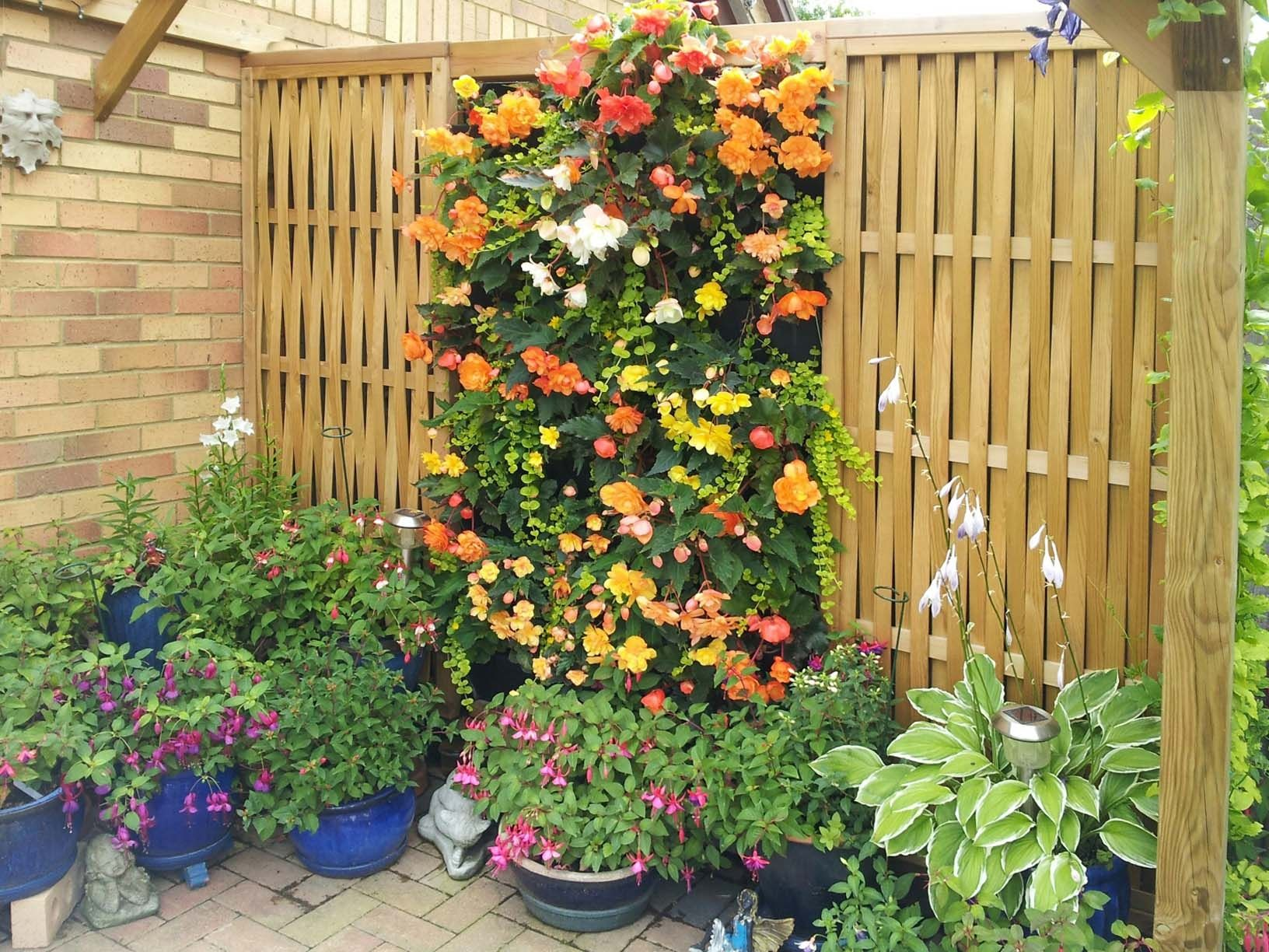 a living wall with woven fence panels