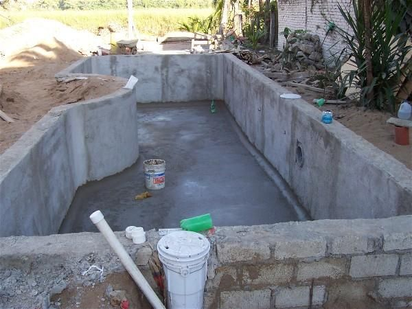 Home built swimming pool building a swimming pool in for Building an inground pool