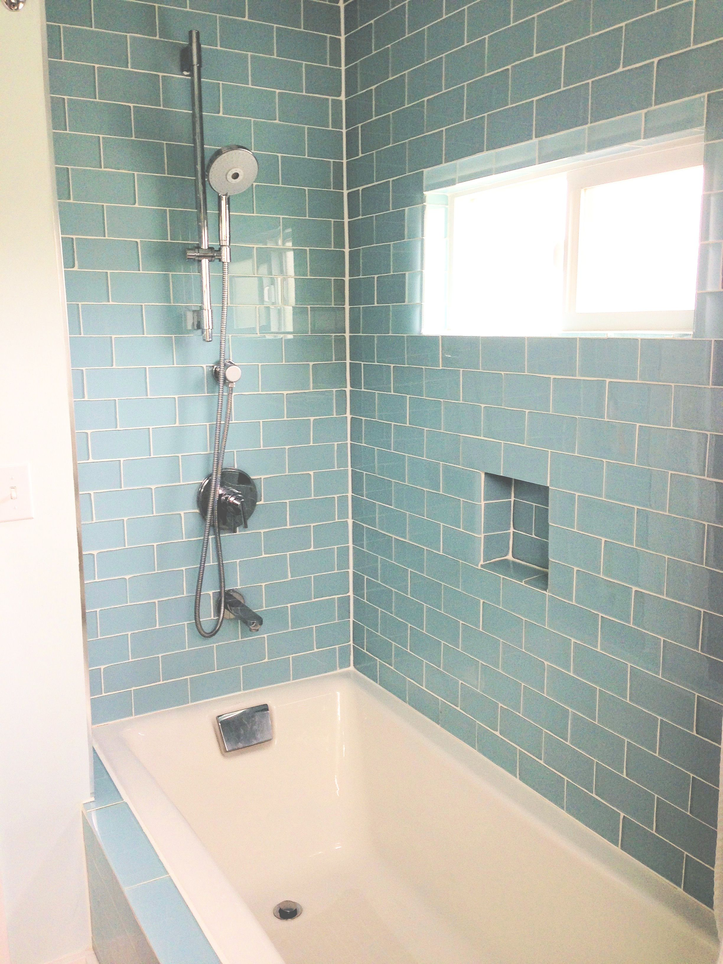 Cool baby blue tiles for an updated bathroom shower and tub ...