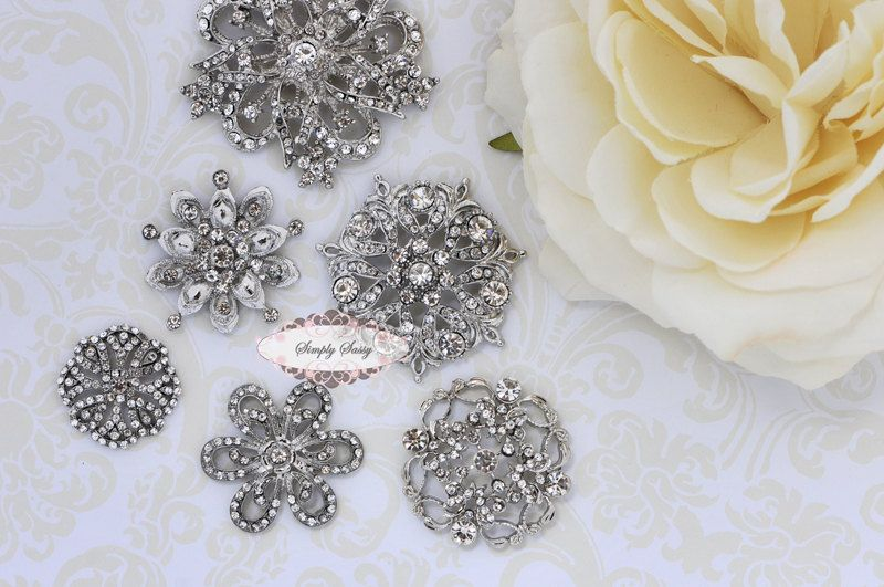 Check out this site for dress embellishments!!  6pc Set GORGEOUS Rhinestone Crystal Metal Flatback Embellishment Button Brooches wedding bridal favor invitation crystal bouquet flower hair. $18.50, via Etsy.