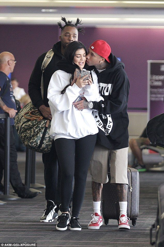 0254af3ca55 Kisses for Kylie Jenner! Tyga plays the doting boyfriend   Fav ...