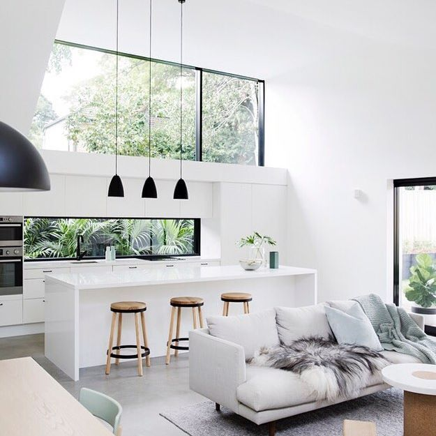 open plan living • kitchen • living • greenery • black framed windows • black pendants • big windows • high ceilings • australian home • australian design || dreams by @architectprineas with an abundance of light streaming through those strategically placed windows. The beauty is in the architectural details. Built by @element_constructions. Captured by @chriswarnes || open plan space
