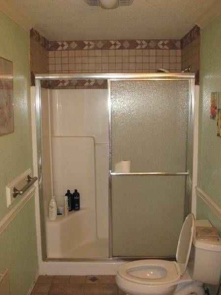 fiberglass shower with wall tile