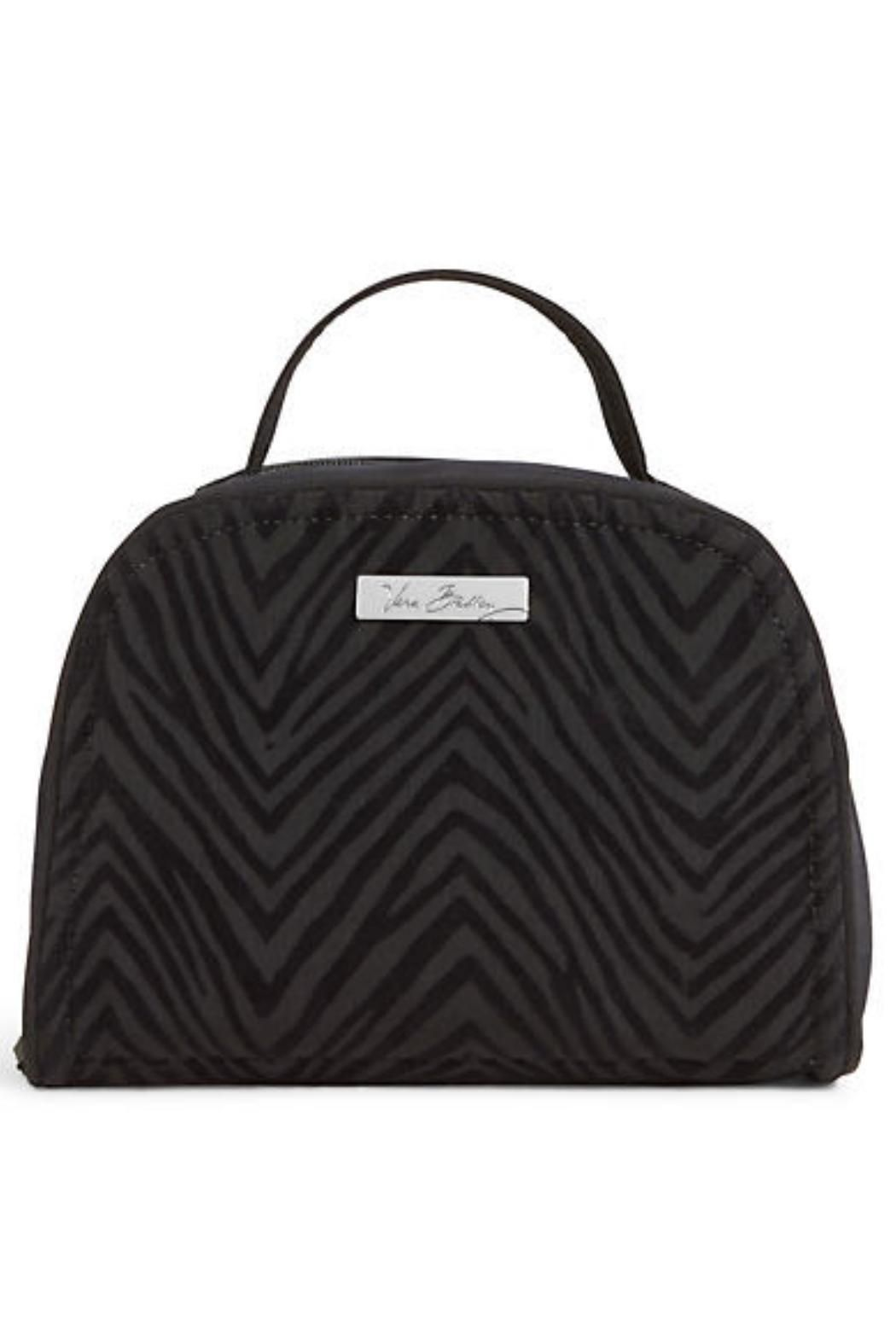 """Meet the Vera Bradley Travel Jewelry Organizer in the Classic Black Flocked Zebra finish.  You're not materialistic but admit it: you enjoy shiny things. Use this travel organizer to take your baubles on the road and never be less than perfectly accessorized again.  Inside two large and four small clear zip pockets and two additional elastic slip pockets. One padded ring strap. Zip closure.  Now what else can we do for you today?    Dimensions 7 """" wide x 5 """" high x 2 """" deep with 2"""" handle…"""