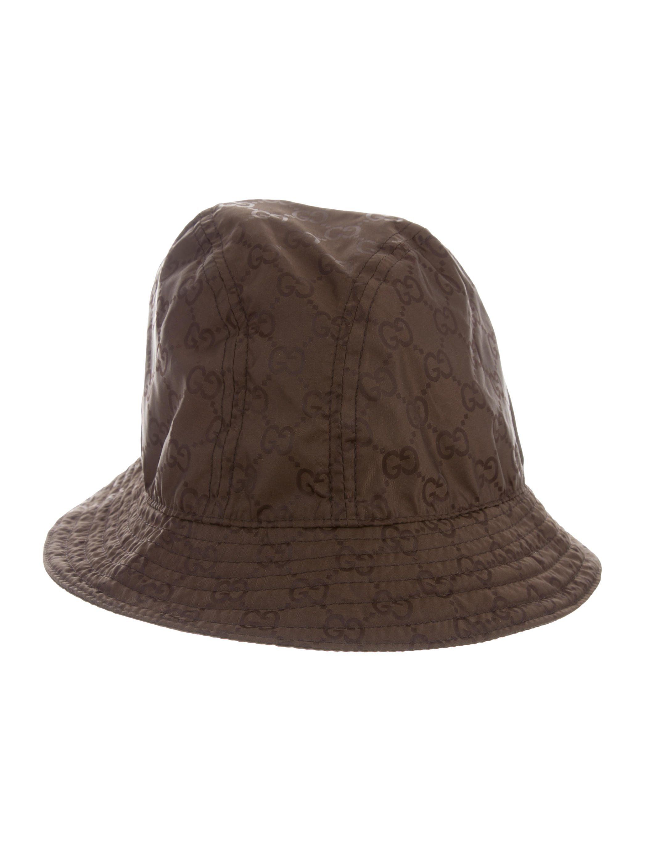 fce32438f1e Men s brown Gucci nylon bucket hat with GG pattern throughout. Designer  size XL.