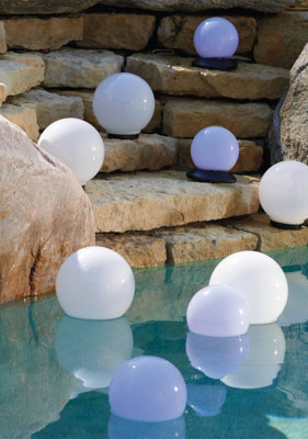 Fun Floating Pool Lights. So pretty for the wedding