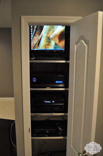 Media closet build into basement bathroom for tv above for Basement closet ideas