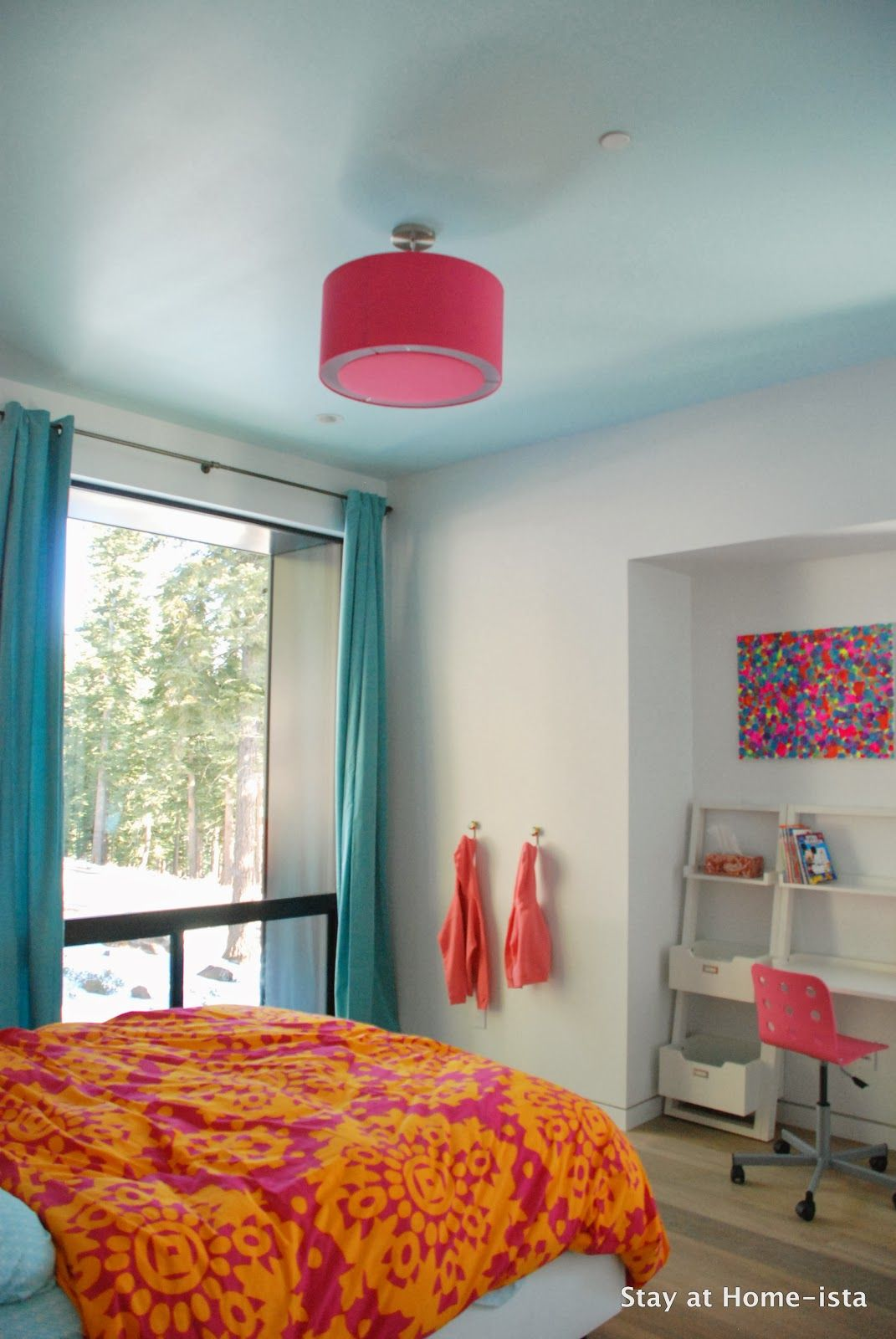 Bright pink, orange and teal in a modern house makes the ...