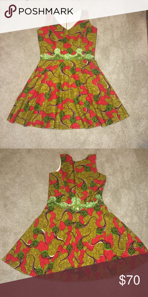 African print Ankara dress Chic and trendy African print dress handmade made in Africa. Has cute green lace detail/ trim around waist! New and never worn. Size 8 women's Dresses Mini