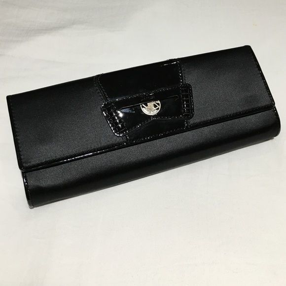 """Black Satin Clutch Black satin clutch with patent detail and jeweled coin on front. Interior has mirror, zip pouch and 4 card slots. Approximately 10"""" x 4"""" x 1"""". Never used! Cole Haan Bags Clutches & Wristlets"""