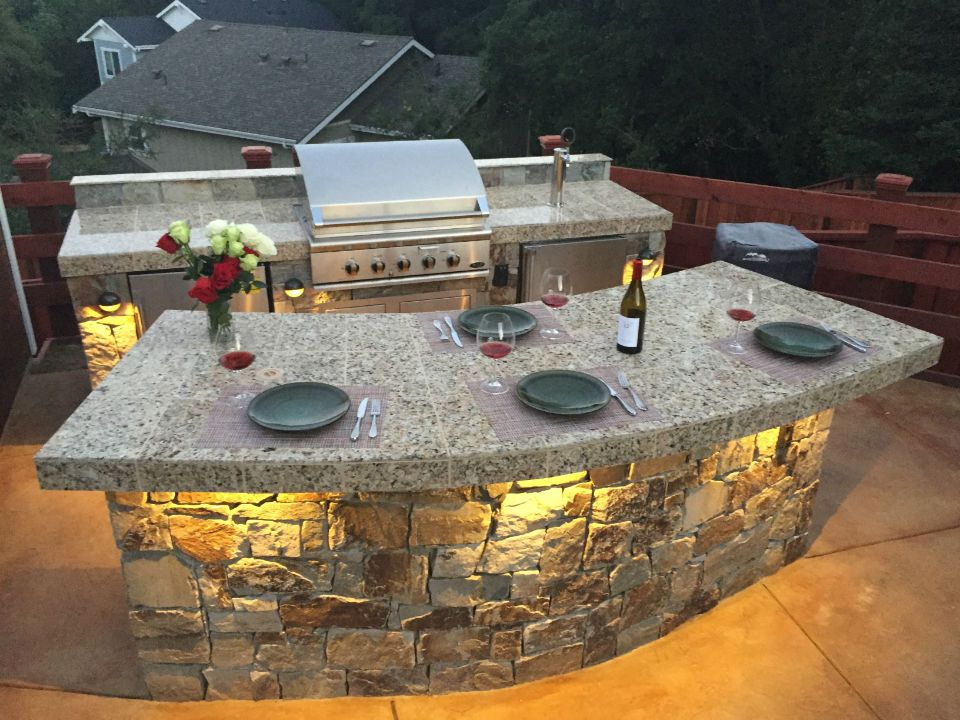 Superior Kitchen Outside The Room With A Bar Counter Made Of Stone Tiles And A Few  Plates And Glasses On The Table Stained Concrete Patio Patio And Fire Pit  Estimate ...