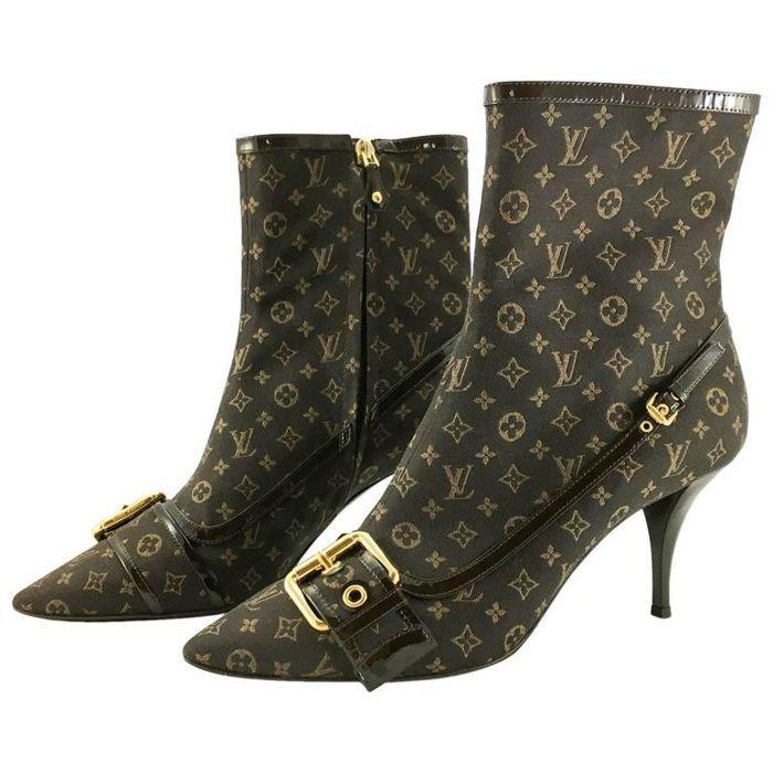 7aec2ffc0e0b Catawiki online auction house  Louis Vuitton - signature boots