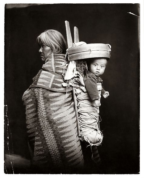 Navajo Indian carrying baby |  Photographed in the early 1900s, by William Pennington and Lisle Updike