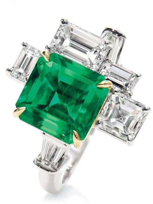 An emerald and diamond ring by Harry Winston, inspired by the traffic and suspension bridges of NYC.