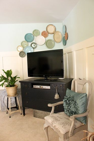 If you are going to hang plates on the wall, this is how it's done... (I for one, don't care for plates on my walls, but I do love this idea.)