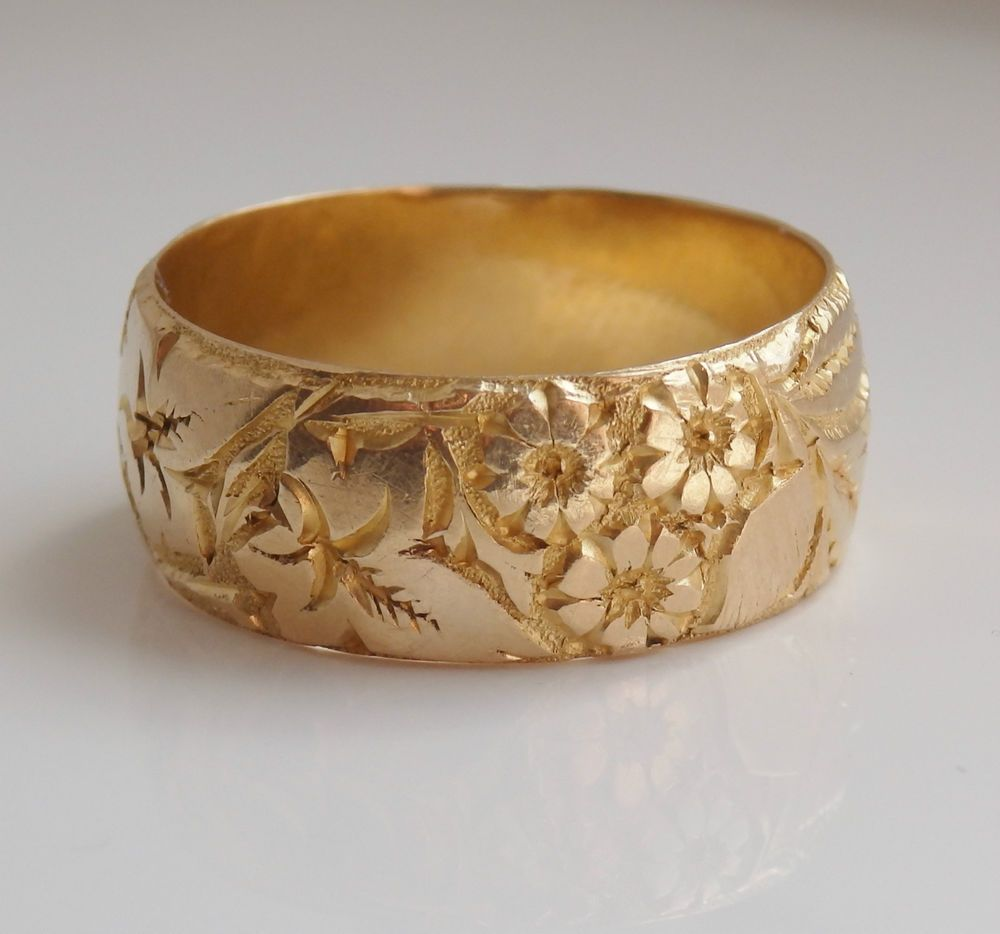 It is a picture of Fine Antique 42ct Gold Wide Floral Engraved Wedding Ring c42; UK