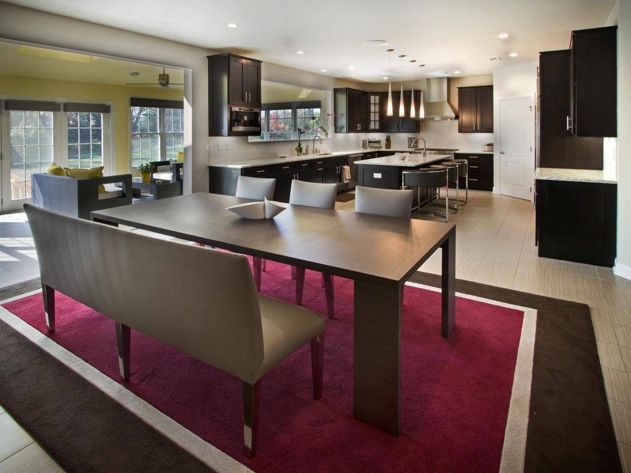 Sleek, modern elegance rules the day in this contemporary New Jersey kitchen. Clean-lined cabinetry in an ebony stain pops against the light-colored countertops and backsplash.