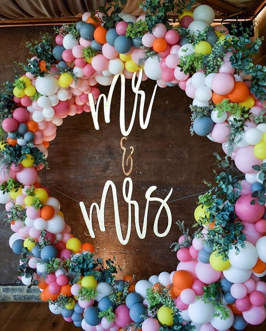 22 Creative Fun Ways To Use Balloons In Your Wedding Wedding Wall Decorations Diy Flower Wall Wedding Flower Wall Backdrop