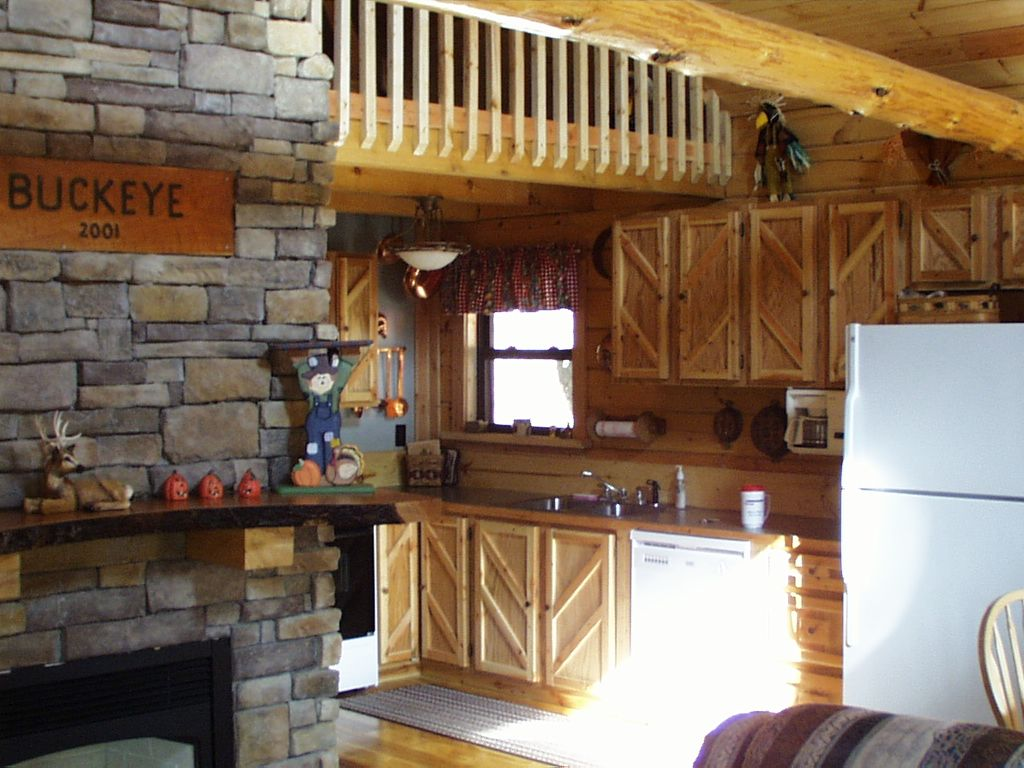 logan deluxe in cabin koa outdoorsman full photos cabins hills kitchen hocking ohio campgrounds camping