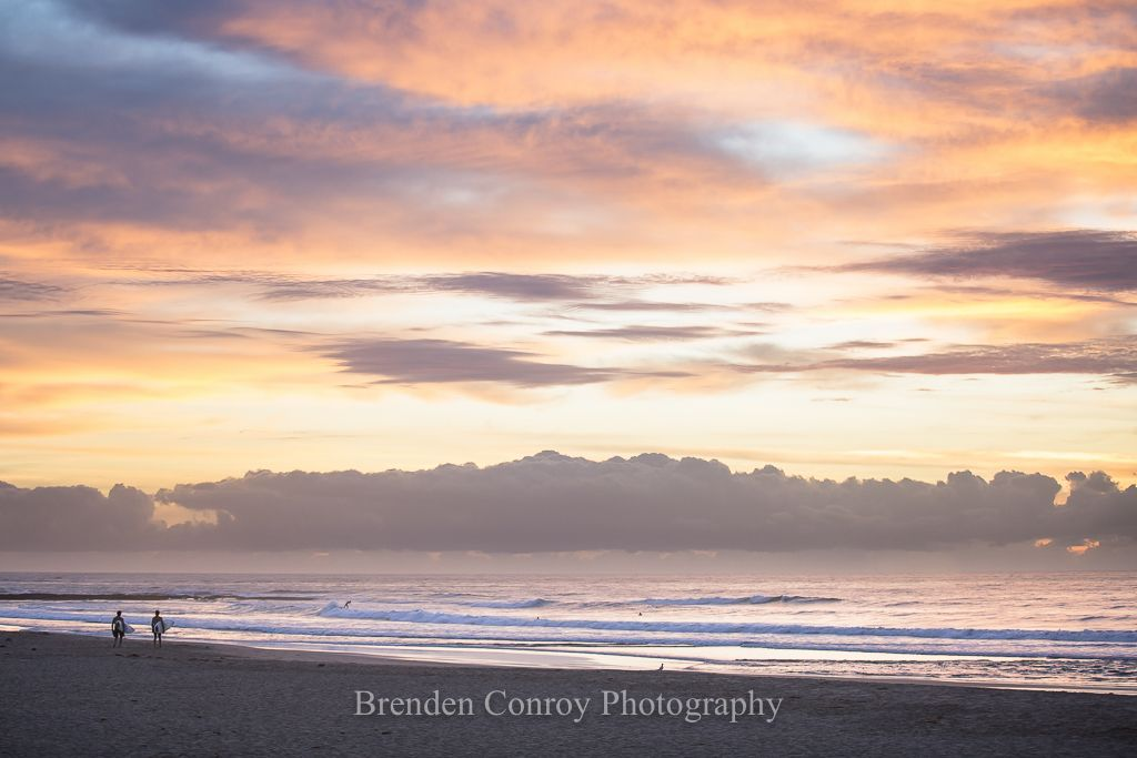 Dawn patrol - Surf and Ocean Art. Surfers entering the water on a colourful morning. Click for more surf and ocean art.