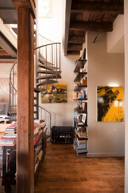 Soaring ceilings with exposed beams and a stereotype-defying patio make a Williamsburg artist's home a thing of beauty