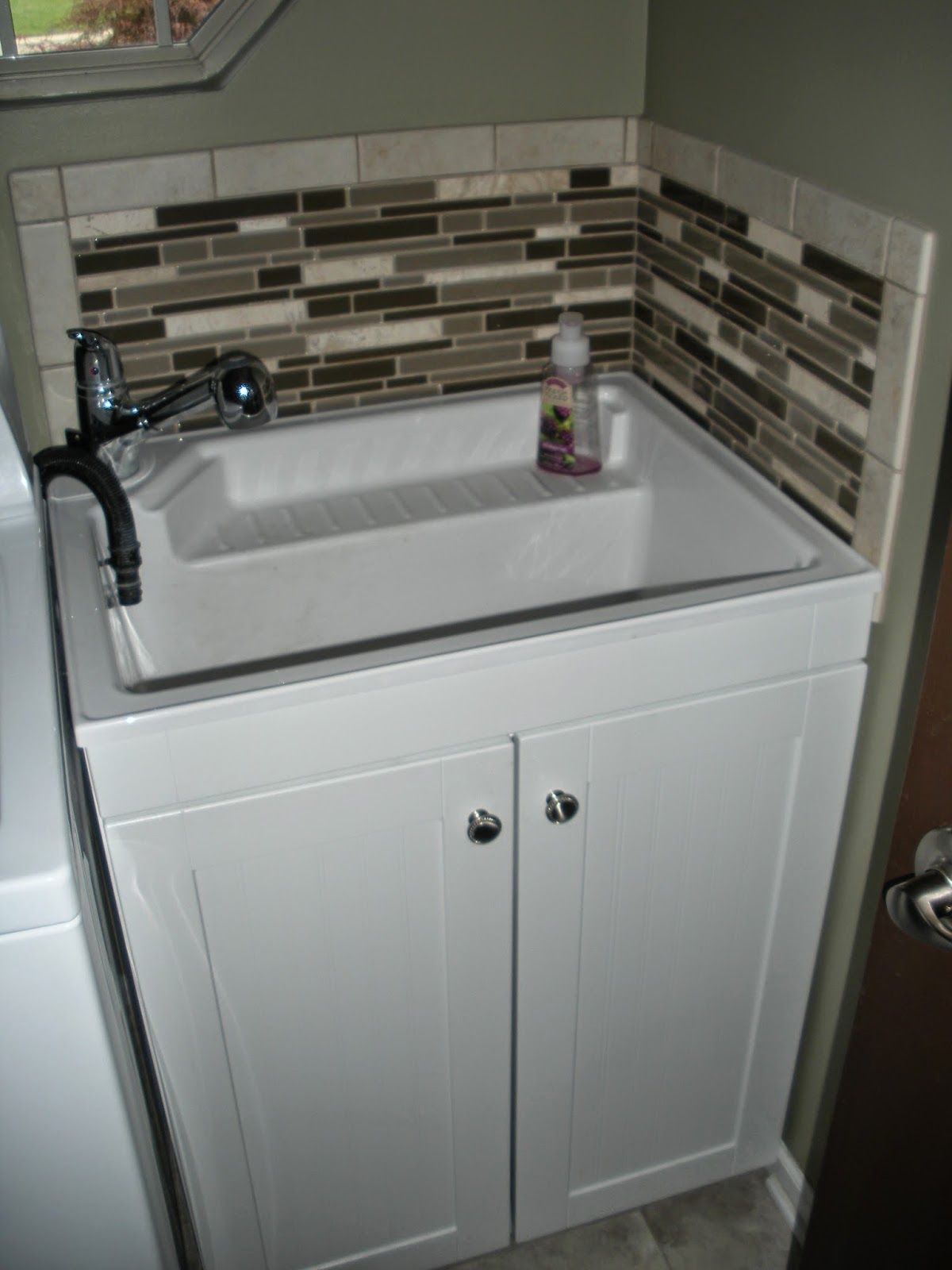 utility sink in laundry room - add tile backsplash to avoid paint