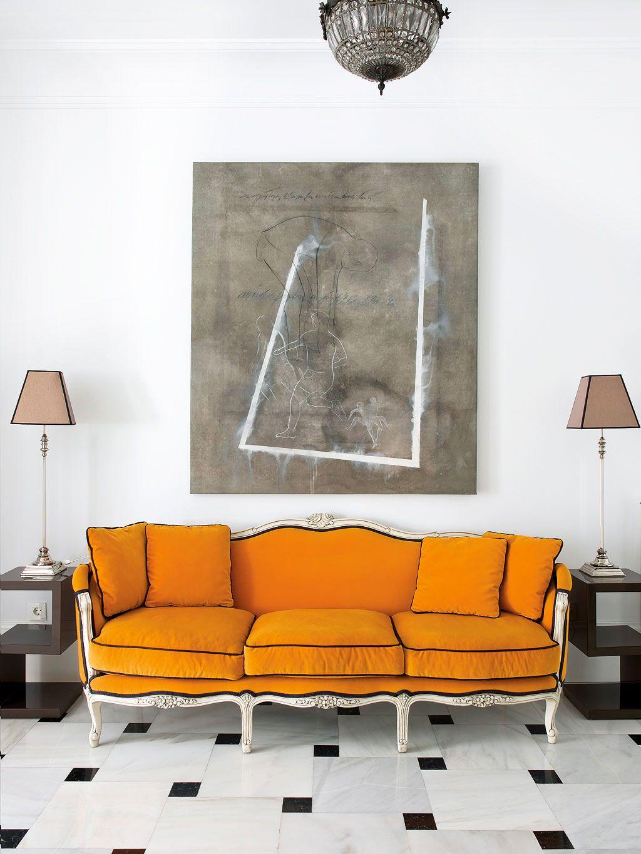 Tour an Eclectic Apartment in Madrid   Orange sofa, Marble floor ...