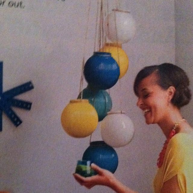 Spray paint glass globes, wrap with string + hang...what about those round glass vases at the dollar store?  Could be painted to look like fishing bobbers or buoys.