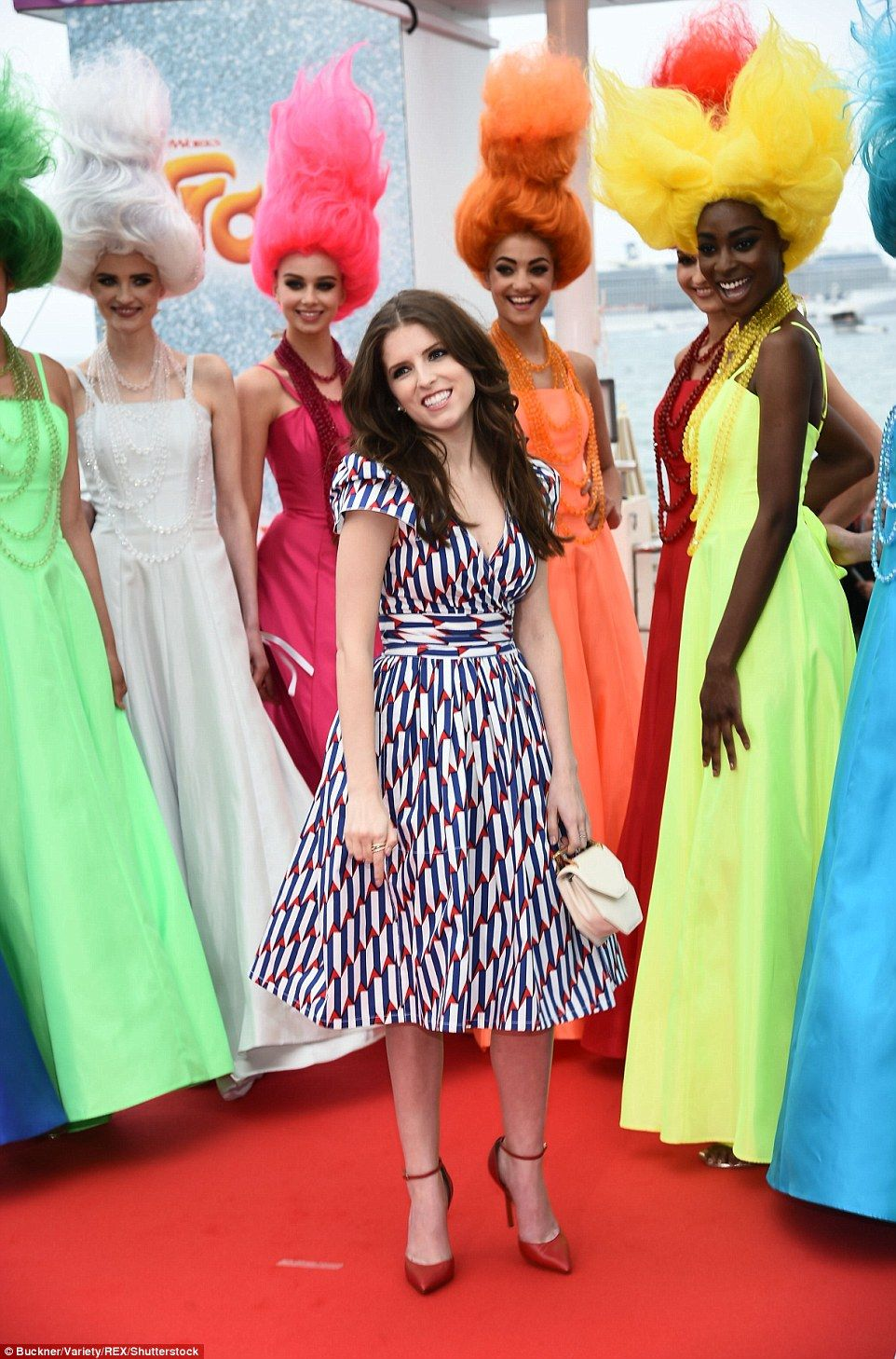 Anna kendrick dazzles in canary yellow cocktail dress in cannes