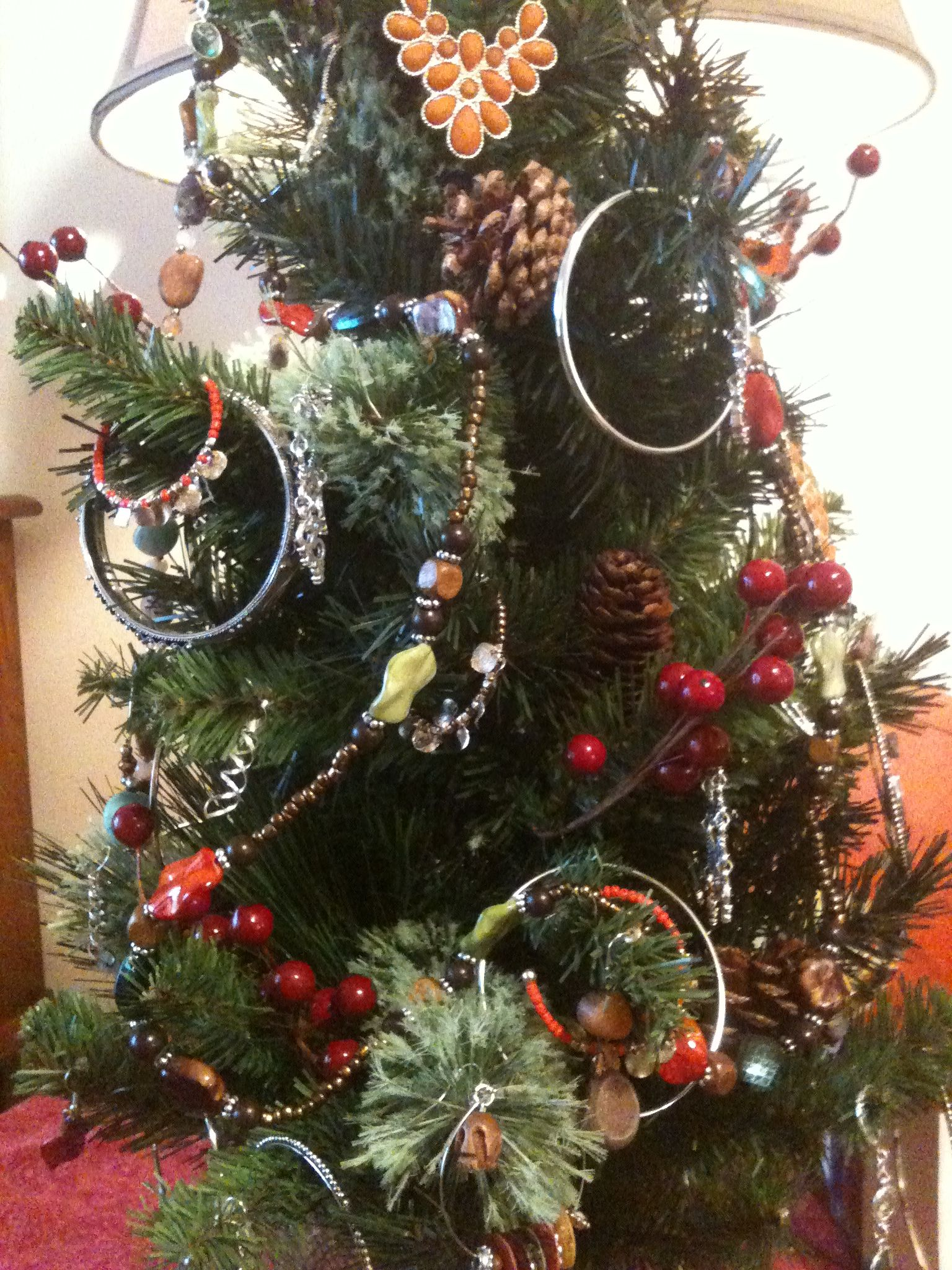 Decorate a Christmas tree with jewelry! So adorable!