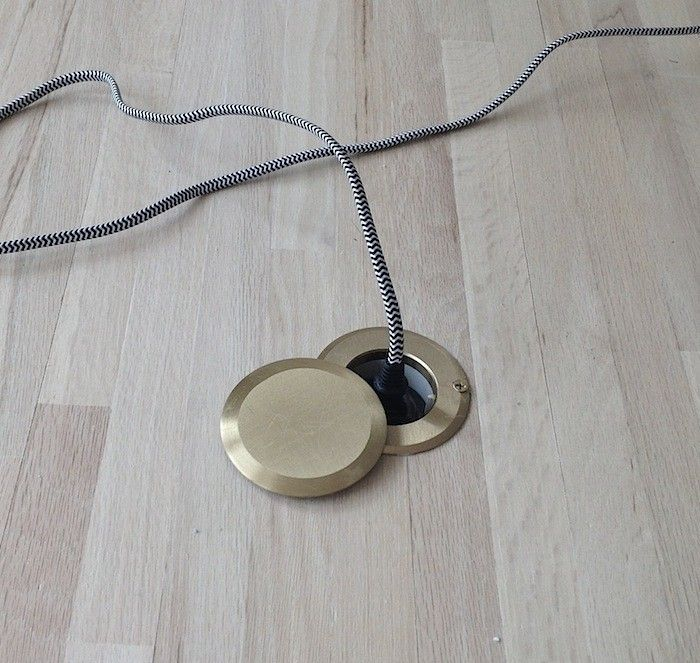 Brass Floor Outlet In Wood