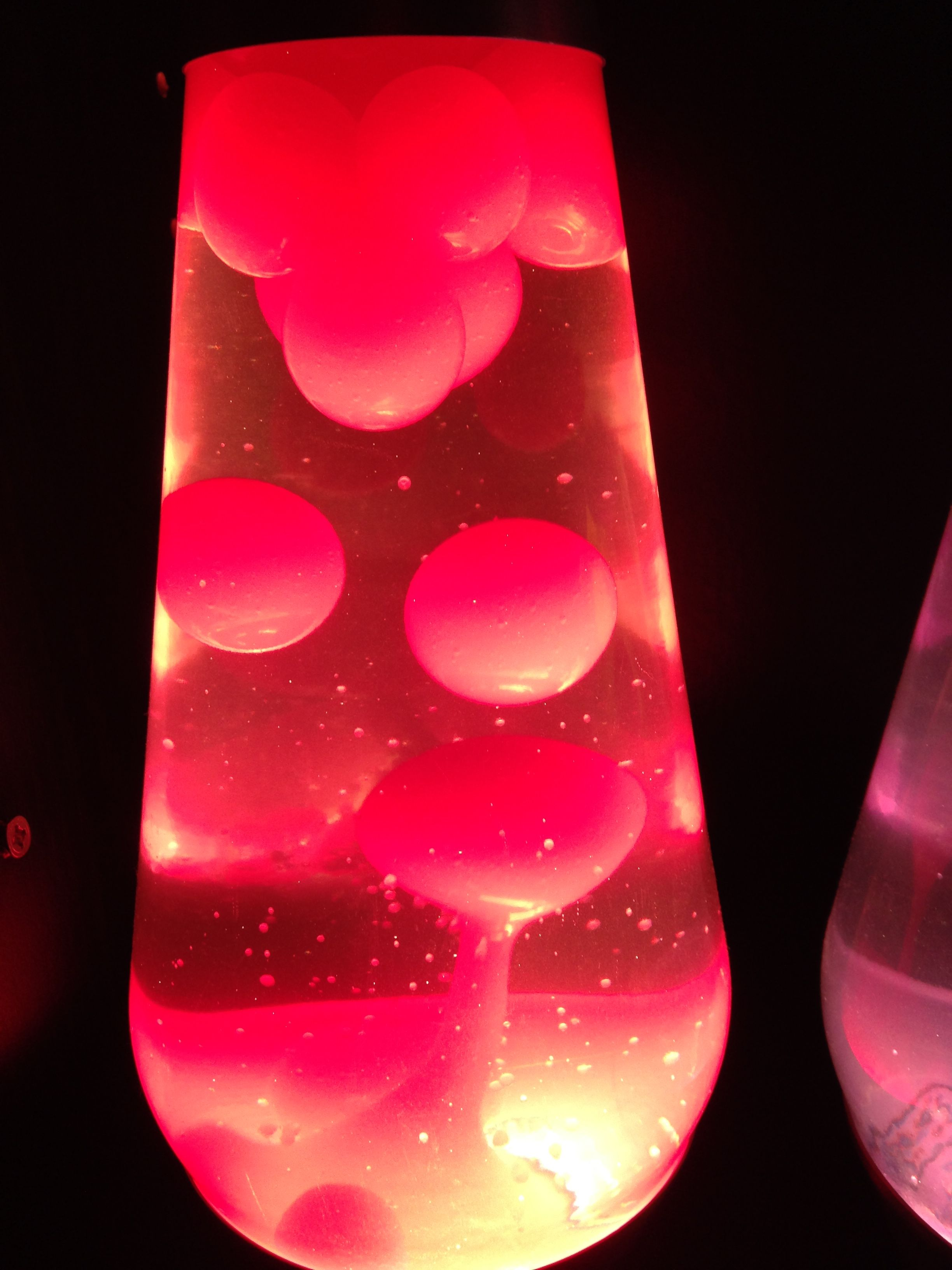 One Premier size lava lamp. Neon pink wax, clear liquid