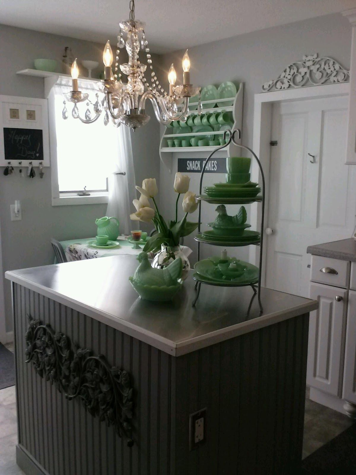 White kitchen with vintage jadite dishes really like this look