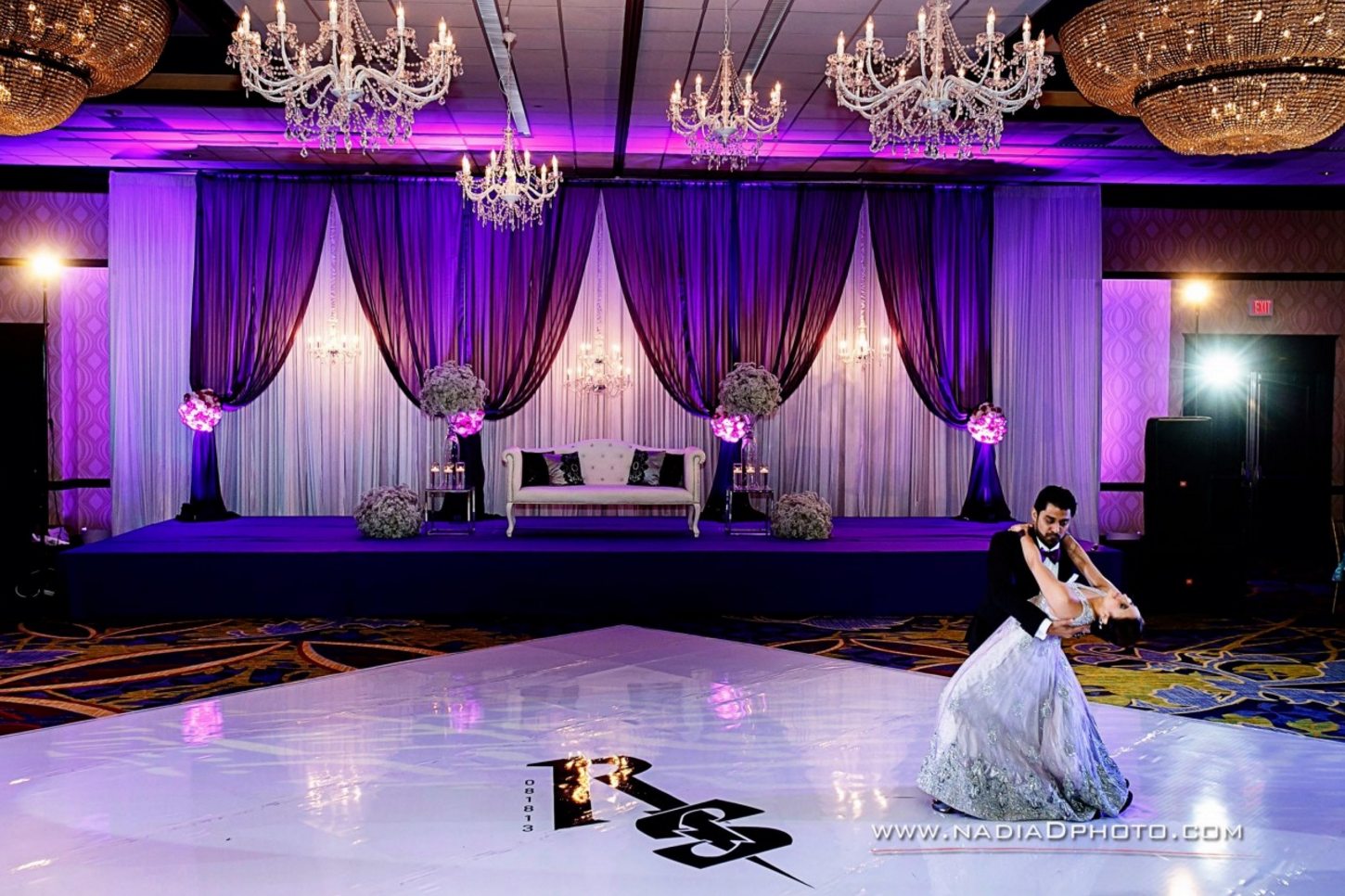Wedding reception stage decoration images  Custom dance floor wrap paired with LED lighting at a wedding event