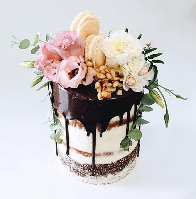 Layers of chocolate brownie, white chocolate & red velvet cake. Dripping with dark chocolate @tome____