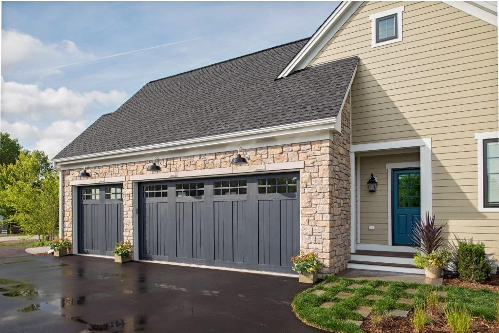 Get The Look Of Wood With Less Upkeep Clopay S Canyon Ridge Collection Faux Wood Carriage House Garage Doo Grey Garage Doors Garage Door Styles House Exterior