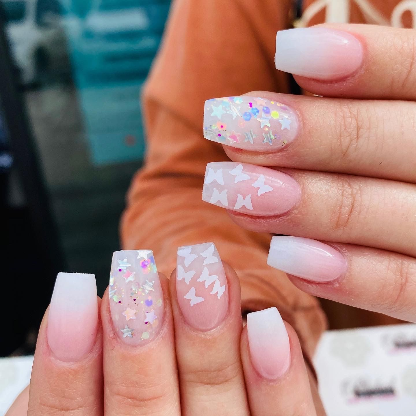 Sweet Pink And White Ombre With White Encapsulated Butterflies Nails Ombre Nails Nail Polish