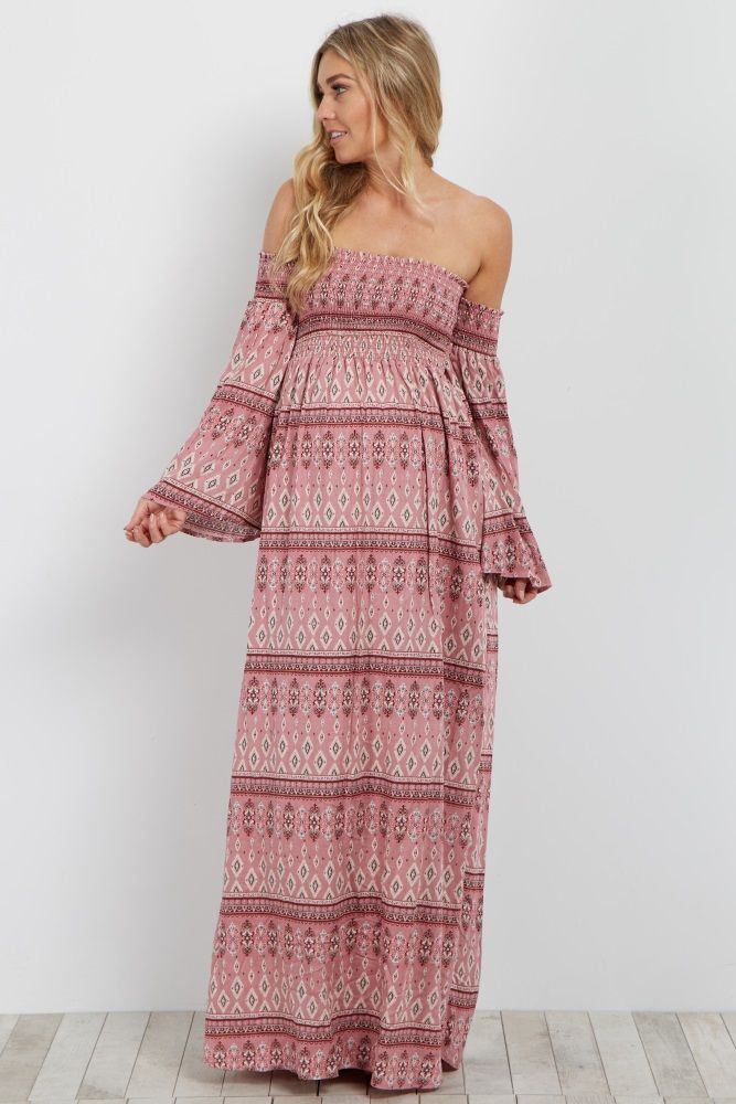 4521c95a2f3 This little beauty is going to be your new essential this season. A smocked  bust and a chic boho sleeve give this maternity maxi dress a stylish look.